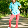 Teenage girl with skateboard - Stock Photo