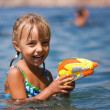 Girl with water pistol — Stock Photo