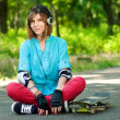 Teenage girl with skateboard — Stock Photo