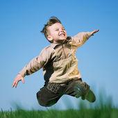 Boy in field — Stock Photo
