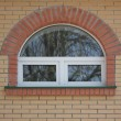 Bricks wall with window in front — Stock Photo #2969821