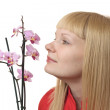 Portrait with orchid — Stock Photo