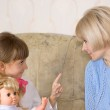 Mum and daughter with a doll — Stock Photo