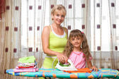 Mother and daughter is ironing — Stock Photo