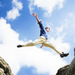 businessman jumping over the mountains, business-konzept — Stockfoto