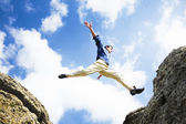 Businessman jumping over the mountains, business concept — Stock Photo