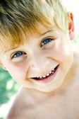 Little boy portrait at the park smiling — Stock Photo