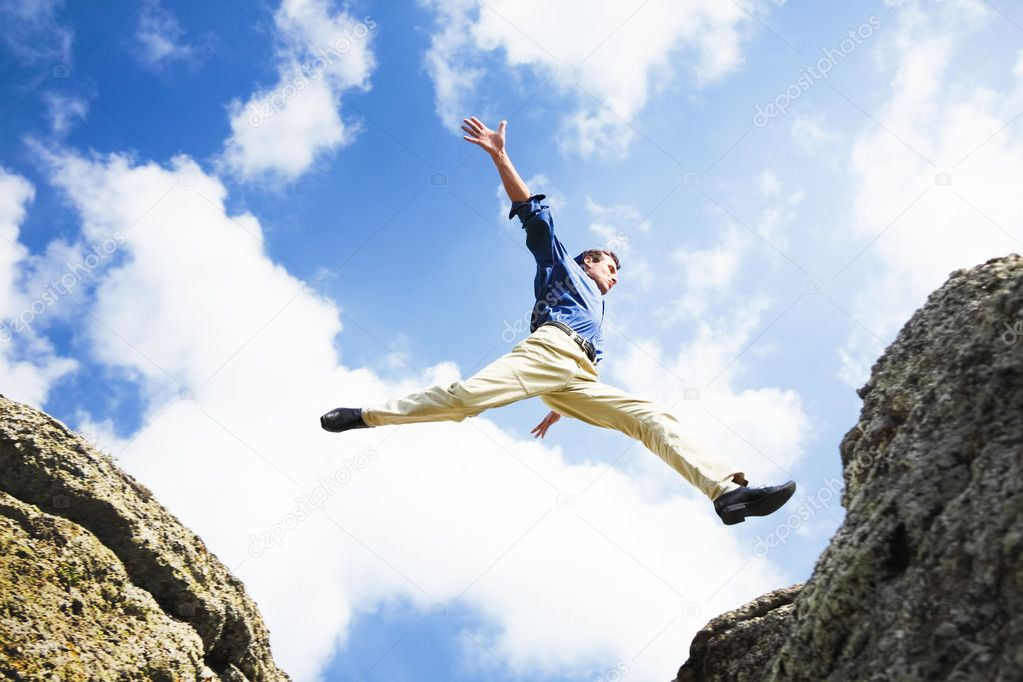 Businessman jumping over the mountains, business concept — Stock Photo #3286416