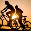 Sporty couple on bicycles - Stok fotoğraf