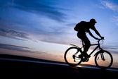 Silhouette of cyclists in motion — Stock Photo