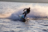 Man jumps on the jetski — Stock Photo