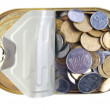 Coins in a tin can . — Stock Photo