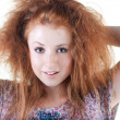 Stock Photo: Portrait of red-haired smiling girl.