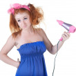 Royalty-Free Stock Photo: Red-haired girl with the hair dryer.