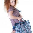 Stock Photo: Tired woman with shopping bag.