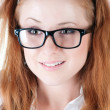 Portrait of the charming red-haired girl in glasses. — Stock Photo