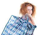 Tired woman with shopping bag. — Stock Photo
