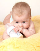 Cute baby with bottle of milk — Stock Photo
