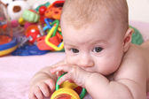 Baby and heap of toys — Stock Photo