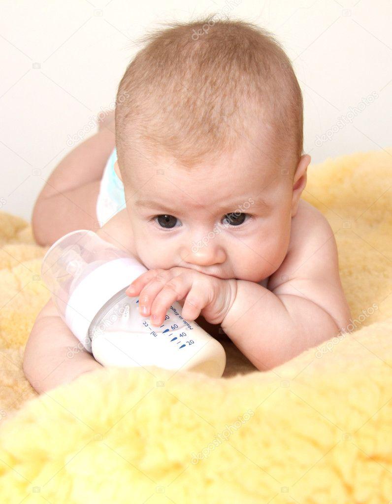 Cute baby with bottle of milk — Stock Photo © niakris #2720572