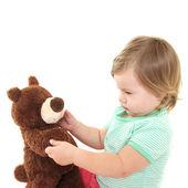 Cute baby girl with her teddy bear — Stock Photo