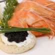 Shrimps and caviar - Stock Photo