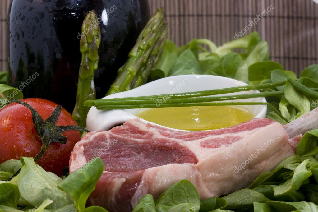 A food background with a rack of lamb and different ingredients — Stock Photo #2882857