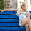 Stock Photo: Young woman sit on the bench