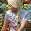 Blond girl in flower — Stock Photo #2817202