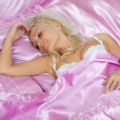 Stock Photo: Young caucasian woman sleep in bed