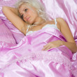 Young caucasian woman sleep in bed — Stock Photo