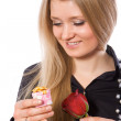 Pretty girl hold red rose and gift — Stock Photo