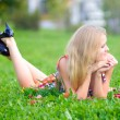 Woman lying on a green grass — Stock fotografie #2817343