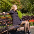 Attractive young woman sit on the bench — Stock Photo