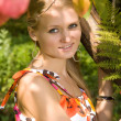 Caucasian woman in summer park — Stockfoto