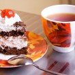 Tea cup and cake - Stock Photo