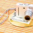 Us money and digital photo camera - Stock Photo