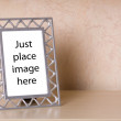 Photo frame on a wooden shelf - Stock Photo