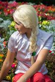 Blond girl in flower — Stock Photo