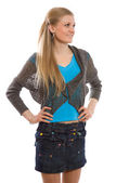 Attractive slim girl with jeans skirt — Stock Photo
