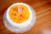 Birthday cake celebrating five years — Stock Photo