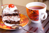 Tea cup and cake — Stock Photo