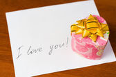 Love letter and gift box — Stock Photo