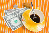 Three dollars and 50 cent pay for coffee — Stock Photo