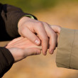 A young couple is holding hands — Stock Photo