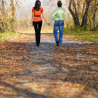 Young couple walking in the park — Stock Photo