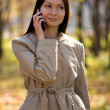 Pretty brunette girl on cellphone — Stock Photo
