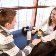 Young couple in cafe — Stockfoto