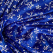 Crumple blue cloth with snowflakes — Stock Photo