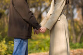 Young couple hold hands — Stock Photo
